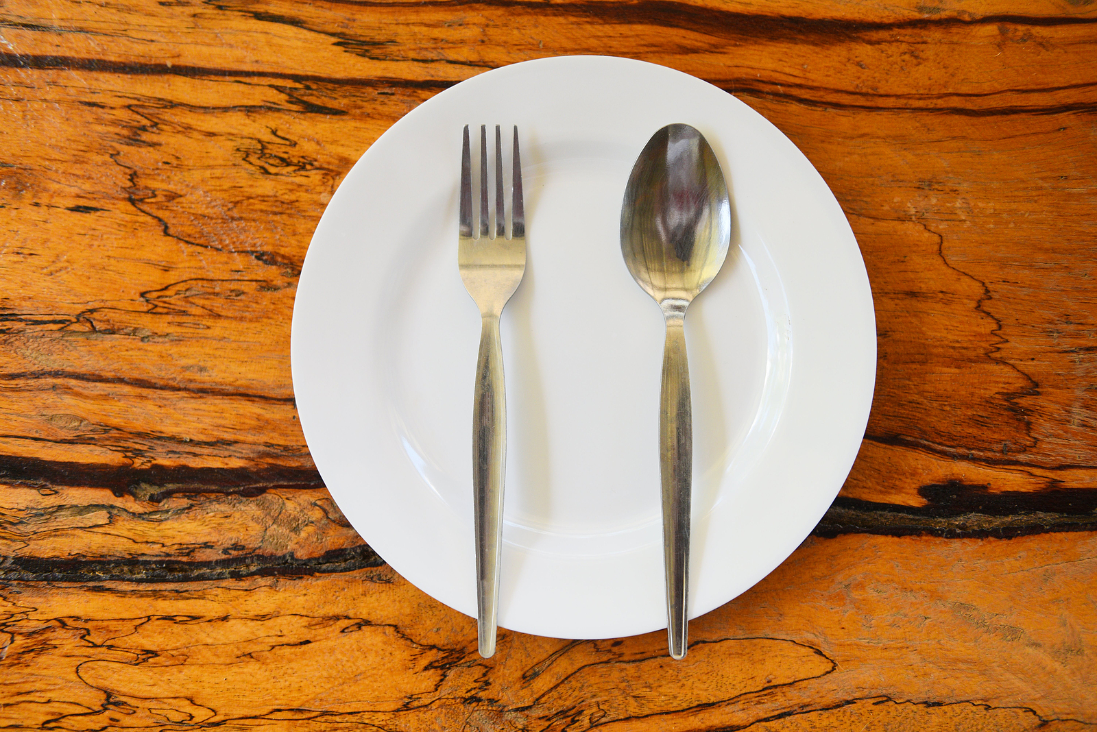 Empty Plate With Spoon Fork On Food Table Wooden Background / Em